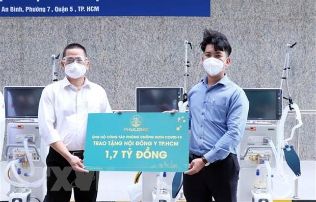 越南祖国阵线中央委员会向南部各省市提供170万份餐食 hinh anh 1