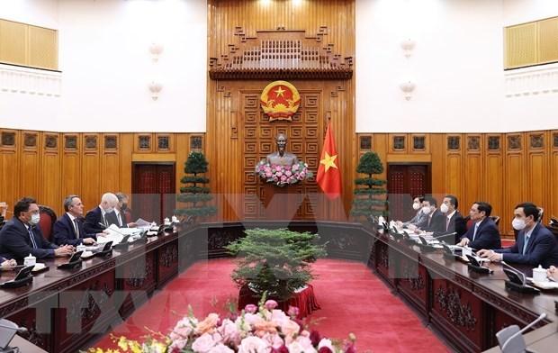 越南政府总理范明政会见瑞士联邦副总统兼外交部长卡西斯 hinh anh 2