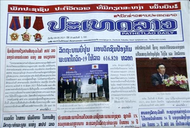 老挝媒体重点报道越南国家主席阮春福访老之旅 hinh anh 1