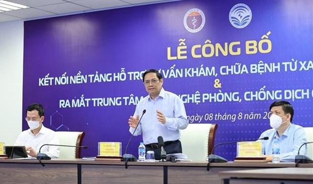 范明政总理出席远程医疗系统与县级医疗机构对接公布仪式 hinh anh 1