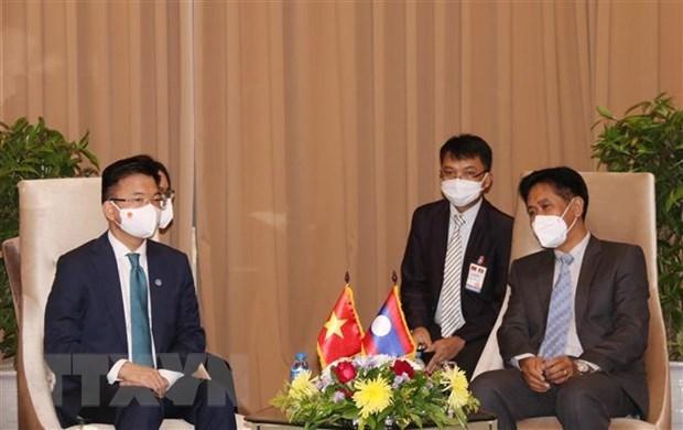 越南与老挝加强工业、贸易和司法合作 hinh anh 2