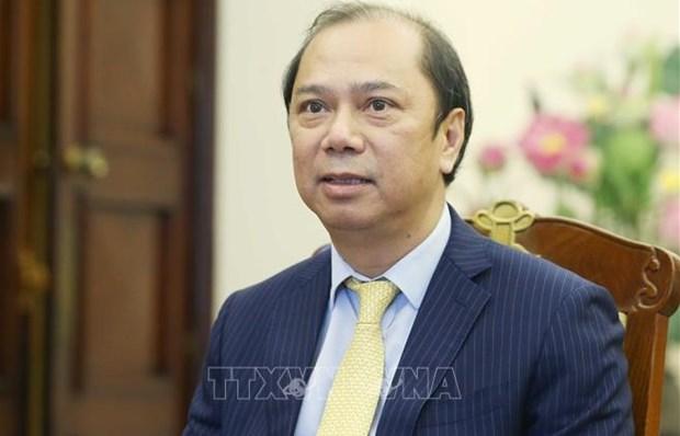 越南外交部副部长阮国勇就越南国家主席阮春福对老挝进行正式友好访问的成果接收了采访 hinh anh 1