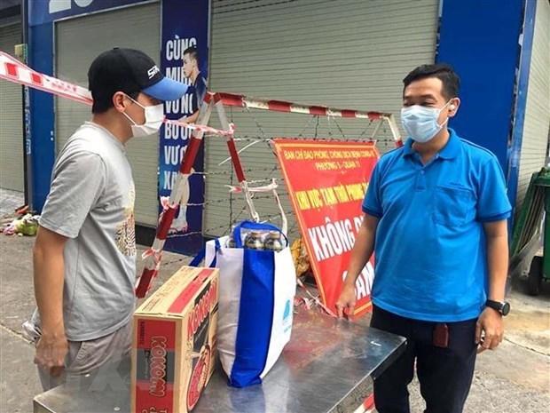 越南劳动总联合会就获得紧急援助对象进行修改和补充 hinh anh 1