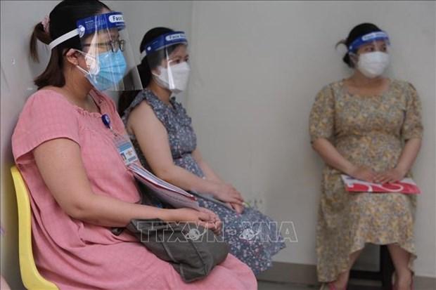胡志明市为孕妇接种新冠疫苗 hinh anh 1