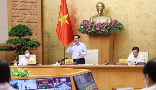 越南政府总理范明政:9月份越南国产新冠疫苗或将上市 hinh anh 1