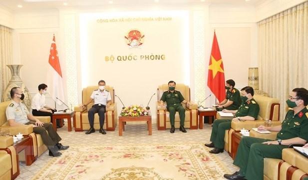 越南国防部提议新加坡向越南转让新冠疫苗生产技术 hinh anh 1