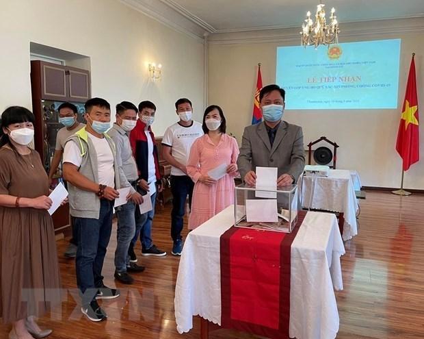 越南驻蒙古大使馆接收支持国内防疫的捐款资金 hinh anh 1
