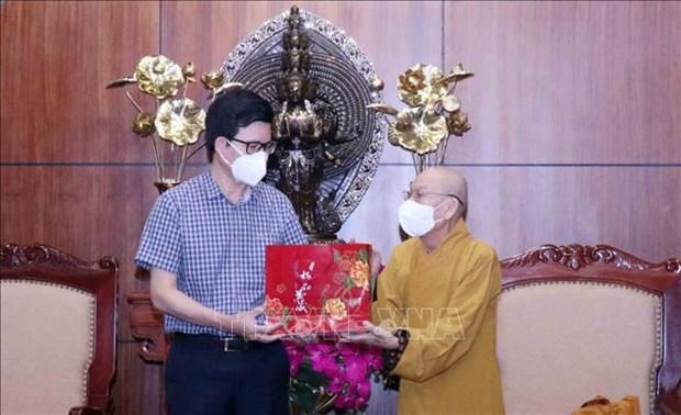 越南政府宗教委员会领导与越南佛教协会胡志明市分会领导举行工作会谈 hinh anh 2