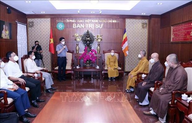 越南政府宗教委员会领导与越南佛教协会胡志明市分会领导举行工作会谈 hinh anh 1