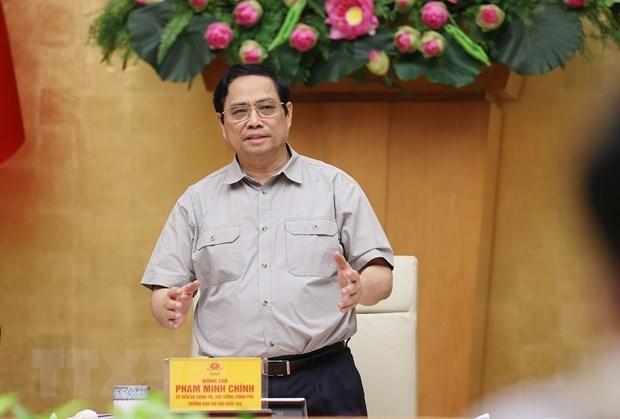 政府总理范明政:力争到9月30日恢复新常态 hinh anh 1