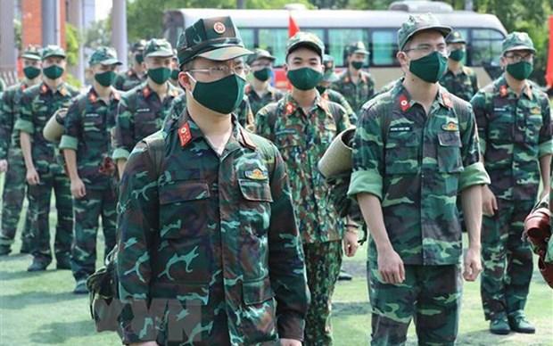 胡志明市和南方各省9月30日之后放宽社交距离措施 军队仍将继续助力做好疫情防控工作 hinh anh 2