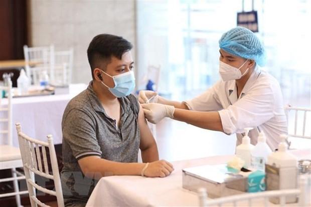 河内市工贸局要求货车驾驶员和装卸工必须完成至少一剂新冠疫苗接种 hinh anh 1