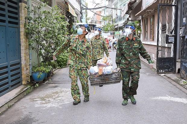 胡志明市和南方各省9月30日之后放宽社交距离措施 军队仍将继续助力做好疫情防控工作 hinh anh 1