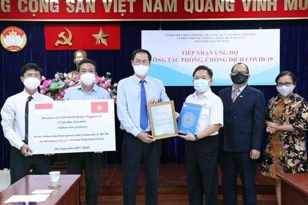 胡志明市外国企业和公民捐赠物资 支援疫情防控工作 hinh anh 1