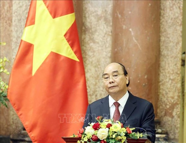 Chu tich nuoc Nguyen Xuan Phuc trao Quyet dinh bo nhiem Tham phan Toa an nhan dan toi cao hinh anh 2