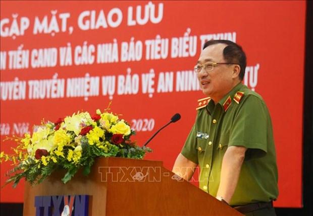 Giao luu dien hinh tien tien Cong an nhan dan va cac nha bao tieu bieu cua Thong tan xa Viet Nam hinh anh 6