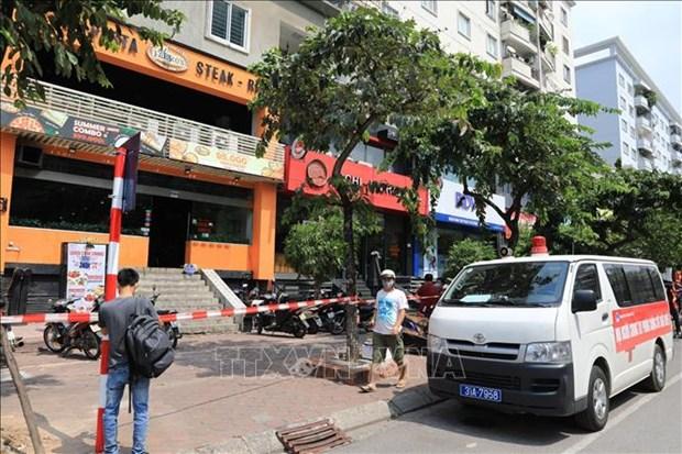 Ha Noi phong toa ngo 230/26 Me Tri Thuong va mot nha hang pizza vi co truong hop nghi mac COVID-19 hinh anh 1