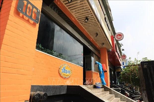 Ha Noi phong toa ngo 230/26 Me Tri Thuong va mot nha hang pizza vi co truong hop nghi mac COVID-19 hinh anh 2