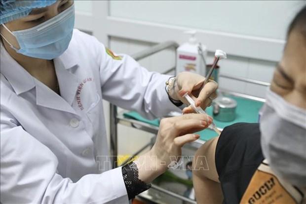 Dich COVID-19: Tiem thu nghiem mui 2 giai doan 2 vaccine Nano Covax cho 26 tinh nguyen vien hinh anh 2