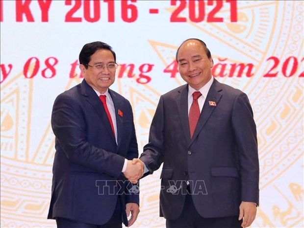 Chu tich nuoc Nguyen Xuan Phuc, Thu tuong Chinh phu Pham Minh Chinh du Le ban giao cong viec cua Thu tuong Chinh phu hinh anh 2