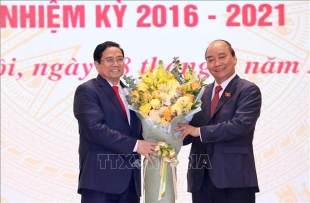 Chu tich nuoc Nguyen Xuan Phuc, Thu tuong Chinh phu Pham Minh Chinh du Le ban giao cong viec cua Thu tuong Chinh phu hinh anh 5