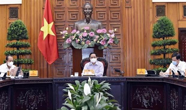 Thu tuong Pham Minh Chinh: Cac bo, co quan ngang bo, co quan thuoc Chinh phu xay dung kich ban bau cu trong dieu kien xay ra dich COVID-19 hinh anh 1