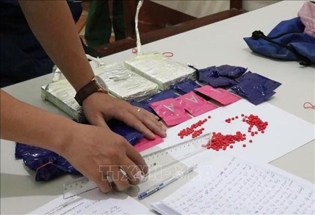 Bat doi tuong Giang A Lau van chuyen 3 banh heroin va 4.000 vien ma tuy tong hop hinh anh 1
