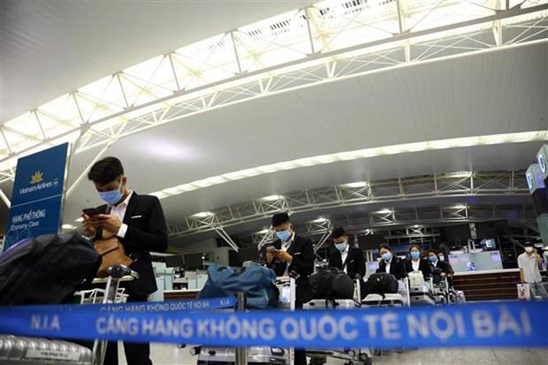 新冠肺炎疫情后越航执行首个定期国际商业航班 hinh anh 2