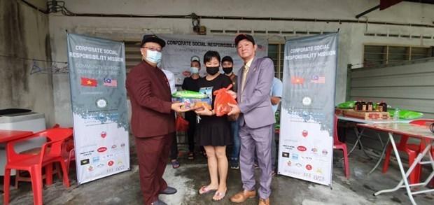 在马来西亚的越南企业与劳动者分享困难 hinh anh 1
