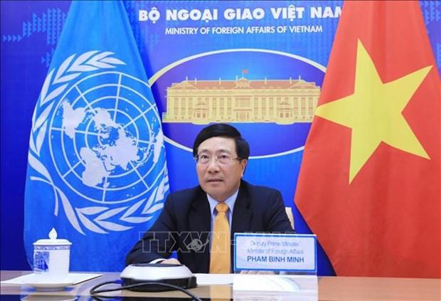 越南政府副总理兼外长范平明出席联合国安理会新冠疫苗问题部长级公开会 hinh anh 1