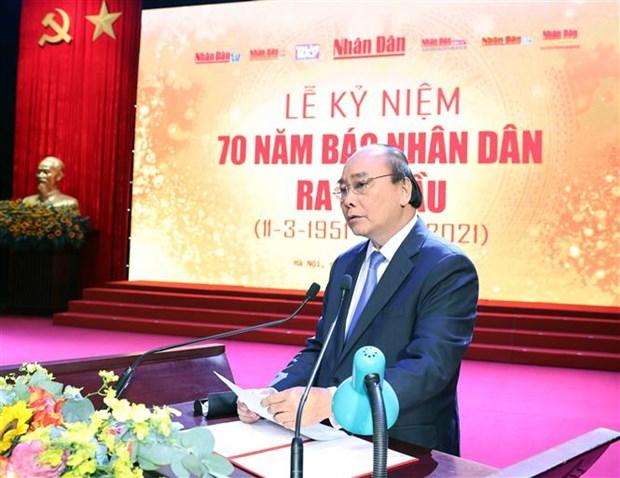 阮春福出席《人民报》创刊70周年纪念典礼 hinh anh 1