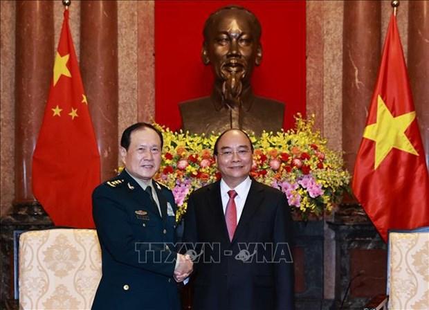 越南国家主席阮春福会见中国国防部部长魏凤和 hinh anh 2