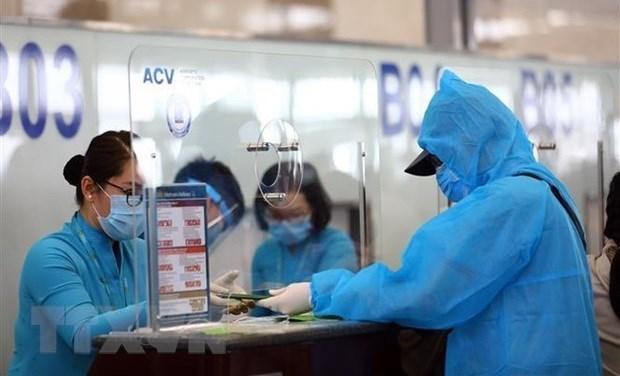 26日上午越南新增3例境外输入病例 全国新冠疫苗接种人数达209632人 hinh anh 1