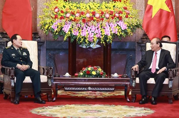 越南国家主席阮春福会见中国国防部部长魏凤和 hinh anh 1