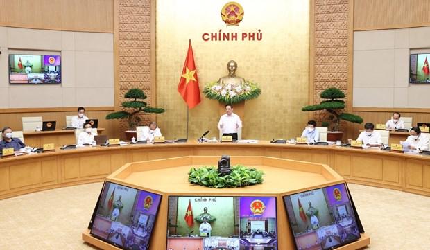  范明政总理呼吁继续强化疫情防控工作 hinh anh 1