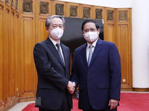 政府总理范明政会见越南驻中国大使熊波 hinh anh 1