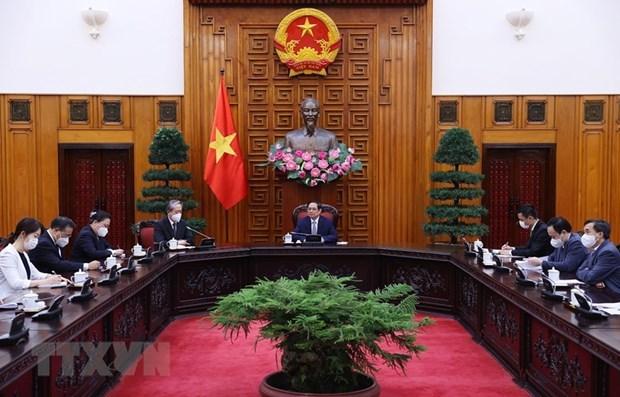 政府总理范明政会见越南驻中国大使熊波 hinh anh 2