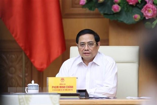 政府总理范明政担任越南国家新冠肺炎疫情防控指导委员会主任 hinh anh 1