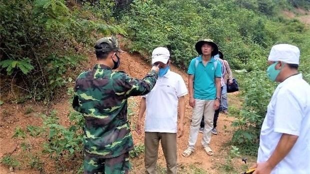 广宁省向中国移交一非法入境和滞留越南的通缉犯 hinh anh 1