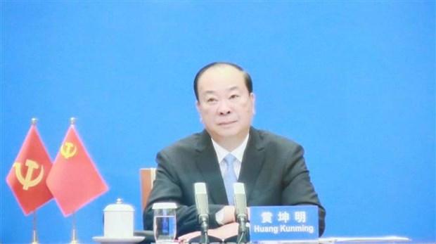 越共中央宣教部部长阮仲义与中共中央宣传部部长黄坤明举行视频会谈 hinh anh 2