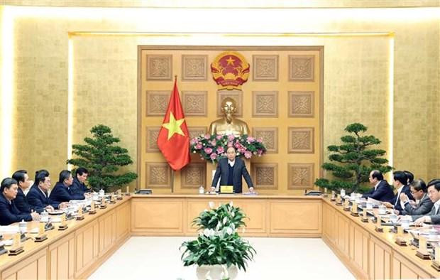 越南政府总理阮春福就经济社会发展情况与各地方领导举行工作座谈会 hinh anh 1