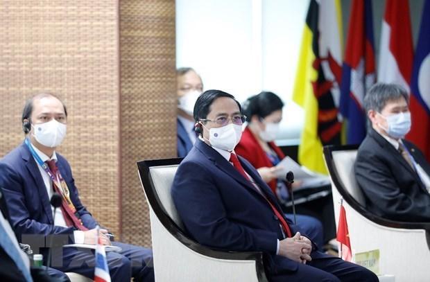 越南政府总理范明政出席东盟领导人会议 hinh anh 1