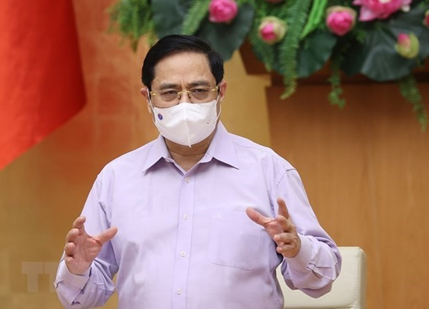 范明政总理:坚决抗击疫情 保护好人民群众的身体健康和生命安全 hinh anh 1