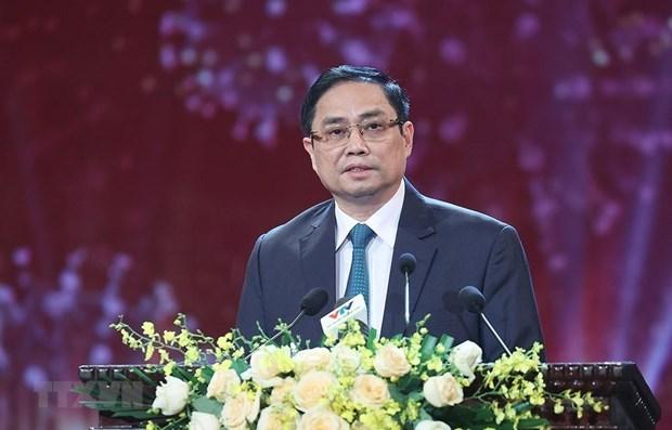 越南政府总理范明政:新冠疫苗基金会是团结基金 hinh anh 1