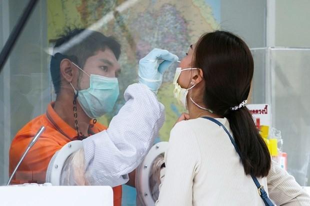 新冠肺炎疫情:老挝呼吁民众按期接种新冠疫苗 泰国推进国产疫苗研制 hinh anh 1