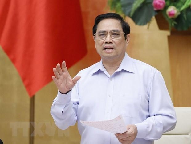 政府总理范明政:各级党委书记亲自担任疫情防控指导委员会主任 hinh anh 1