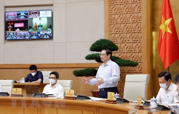 政府总理范明政:各级党委书记亲自担任疫情防控指导委员会主任 hinh anh 2