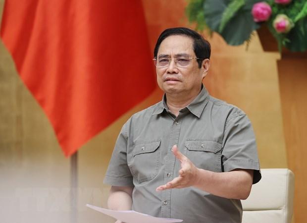 范明政总理:疫情防控不可掉以轻心 急于开放经营活动 hinh anh 1