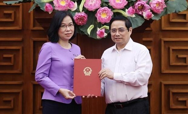 越南政府总理范明政颁发越通社社长任命决定 hinh anh 1